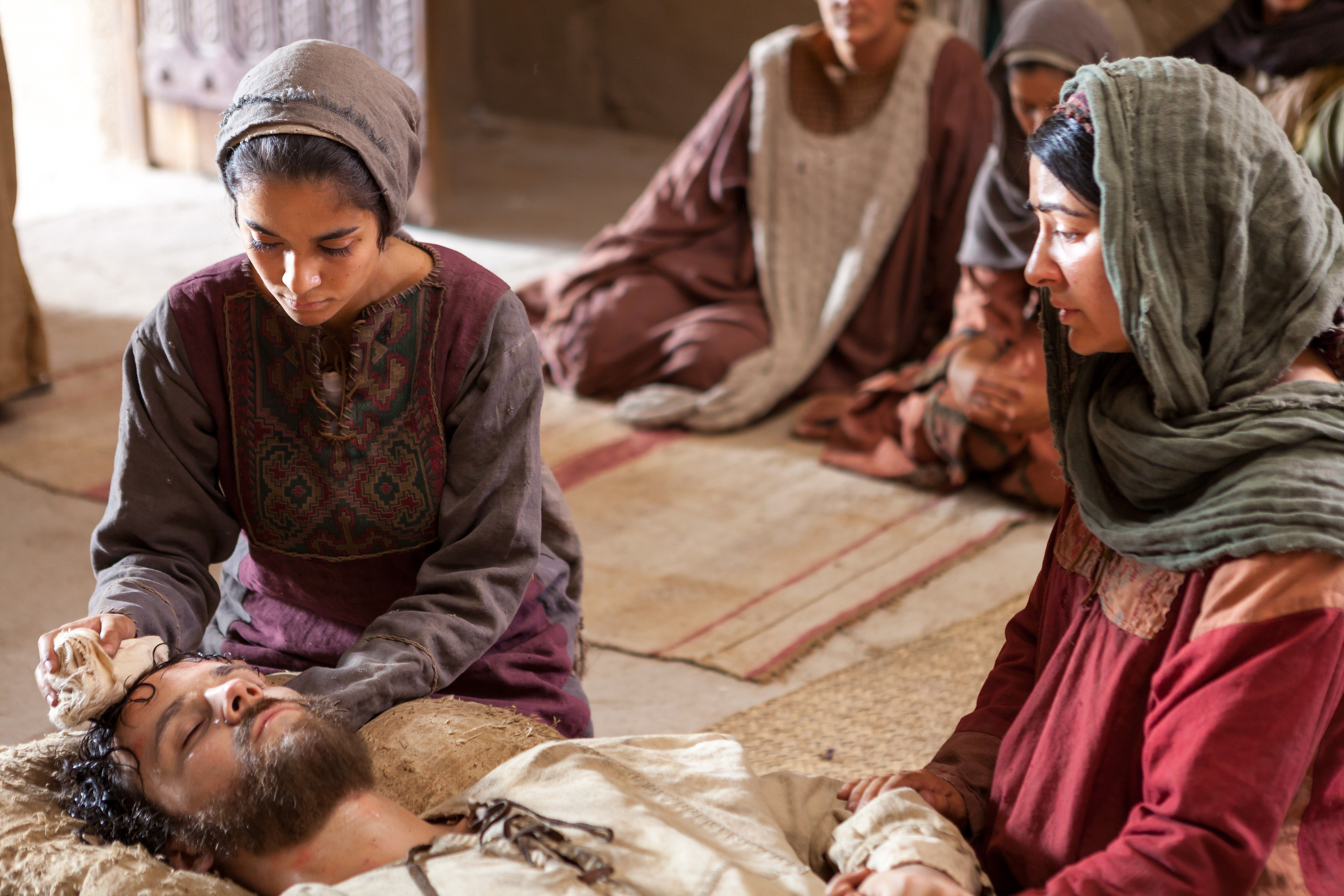 Mary and Martha tending to their brother Lazarus, who is ill.