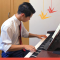 Young Man from Japan Playing Piano