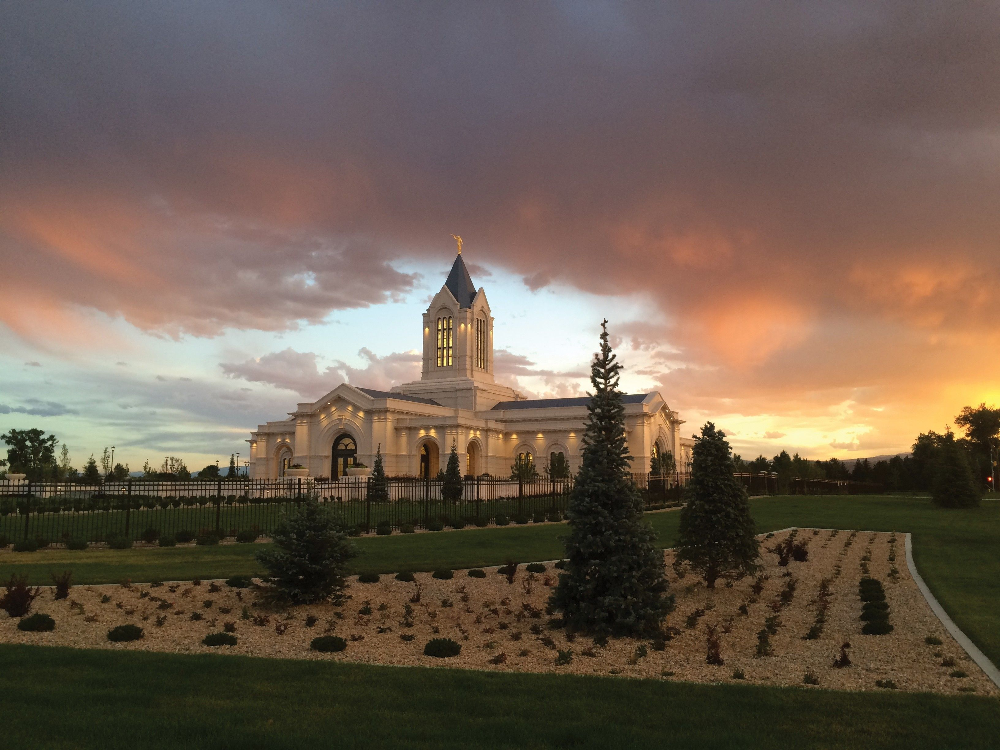 An exterior view of the Fort Collins Colorado Temple at sunset.