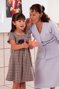 teacher whispering