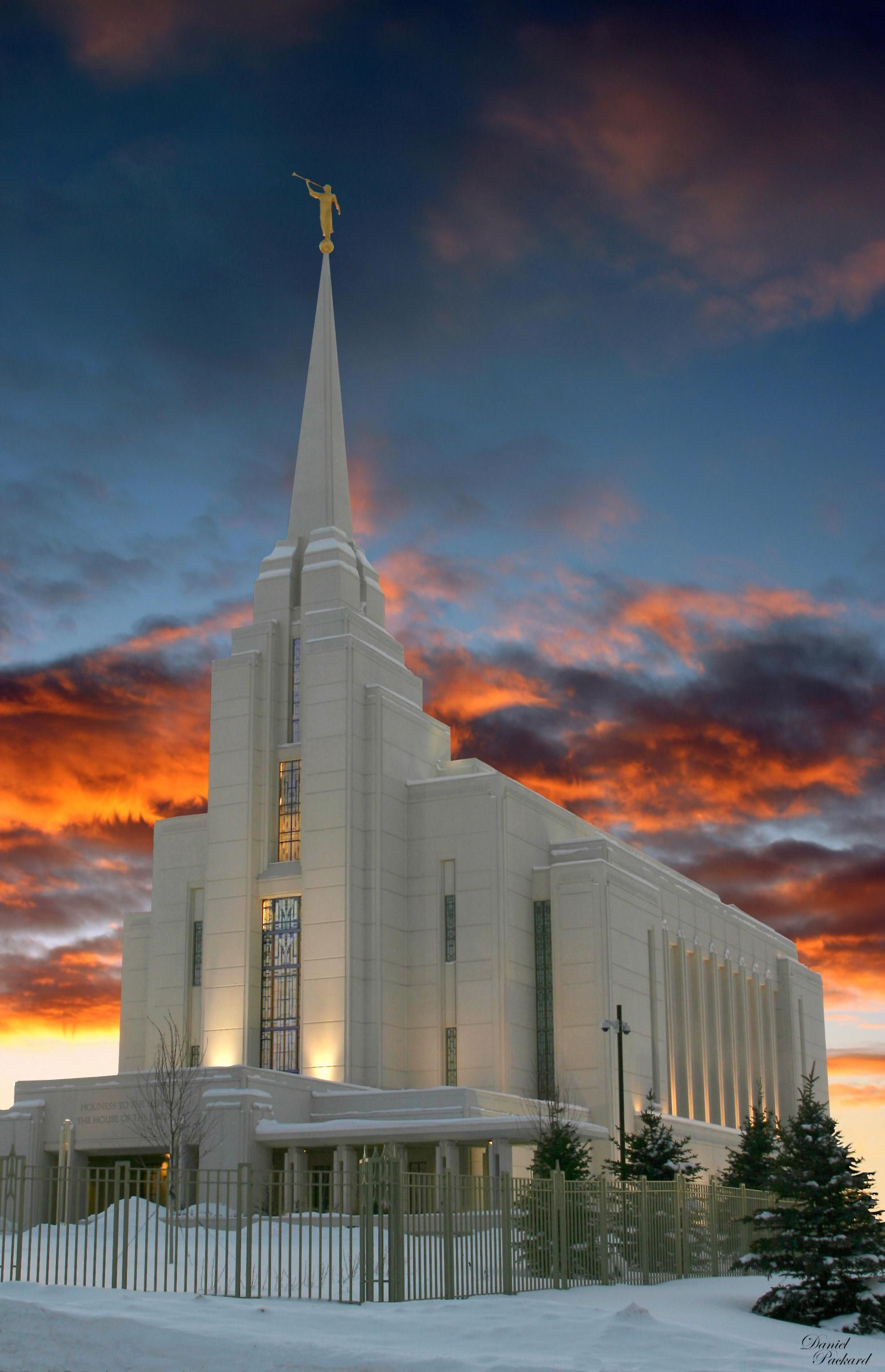The Rexburg Idaho Temple at sunset during winter, including the entrance and scenery.