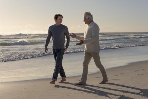 men walking on the beach