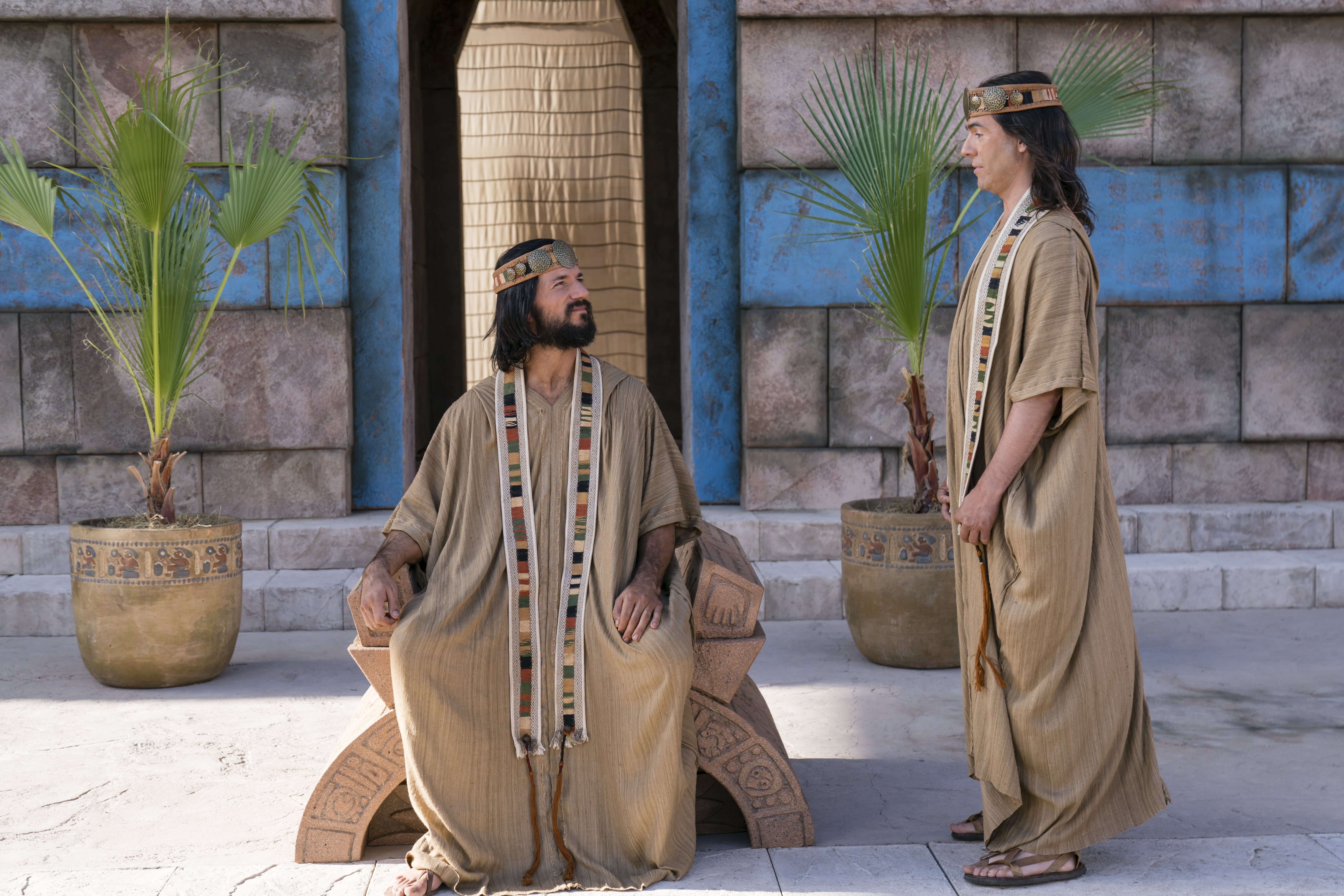 Alma the Younger sits on the judgement seat and speaks with Nephihah in the city of Zarahemla.
