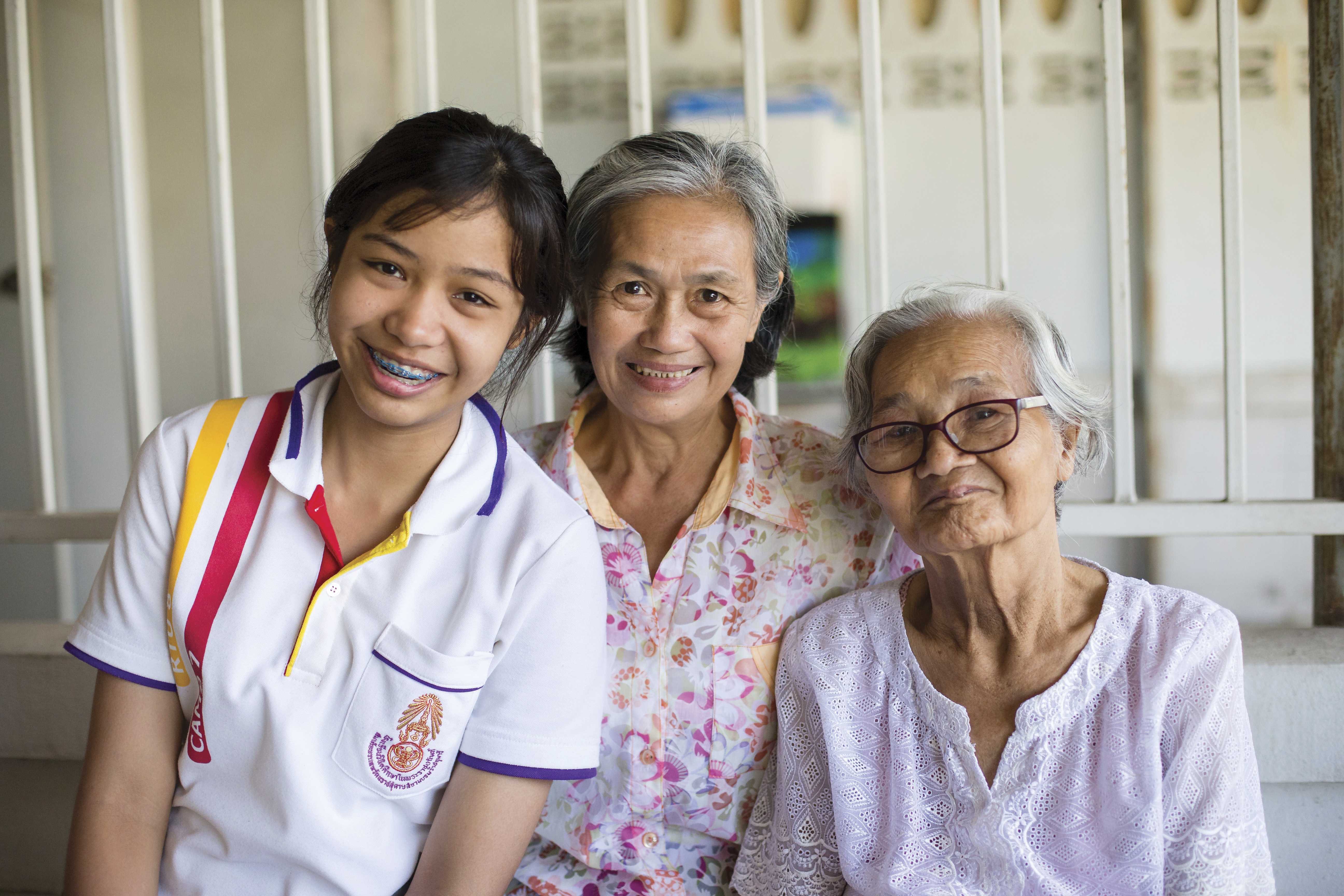 An informal portrait of three generations of women in Thailand.