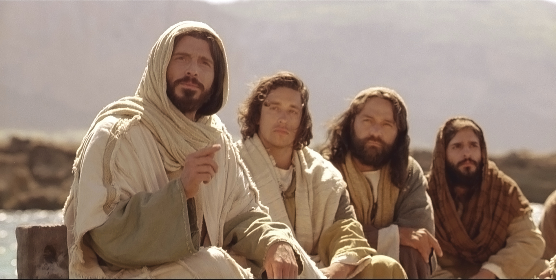While on a ship, Jesus teaches parables to listeners on shore.