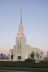 The entrance of the Twin Falls Idaho Temple, with trees on either side and the fence in front.