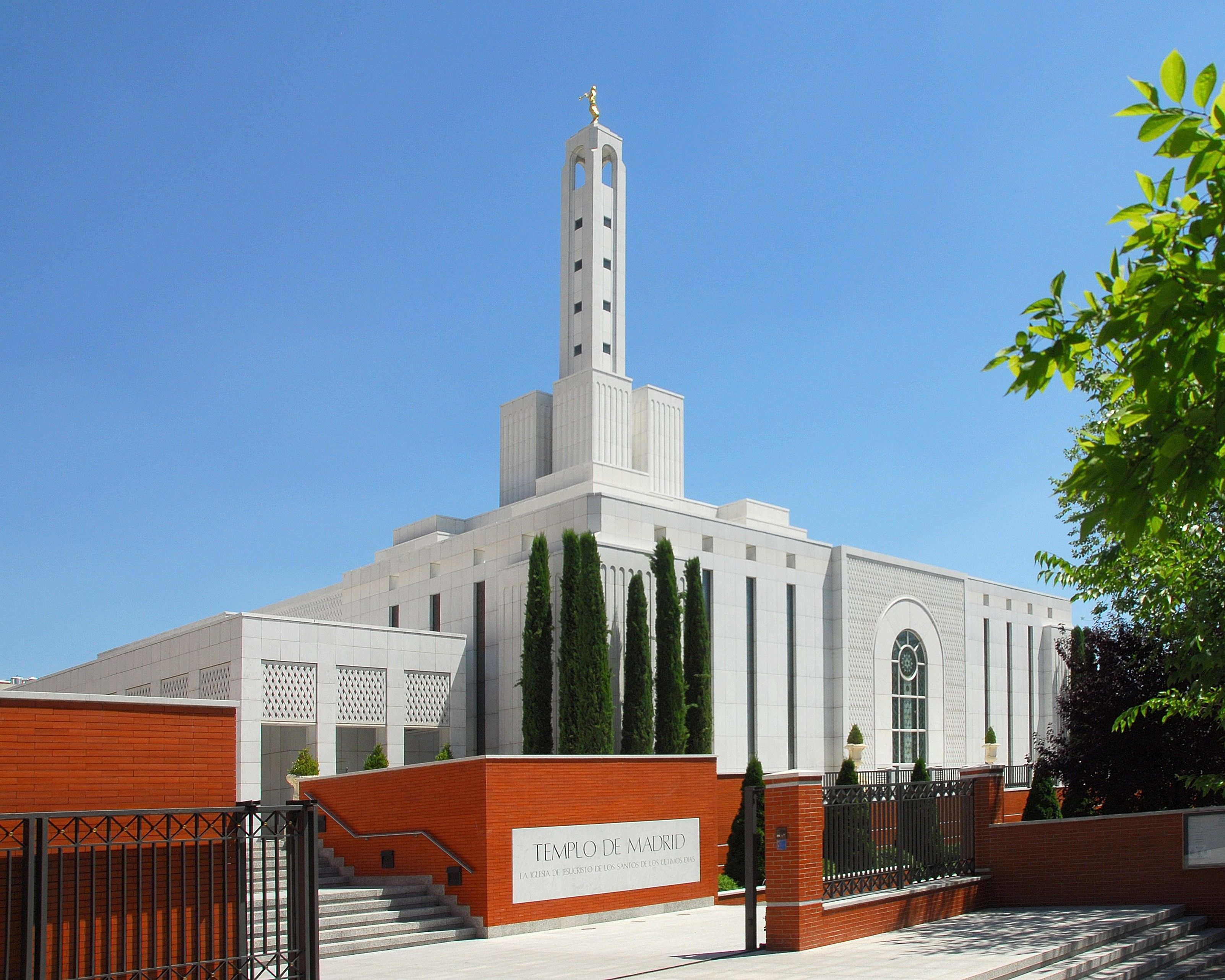 The Madrid Spain Temple name sign, including scenery and the exterior of the temple.