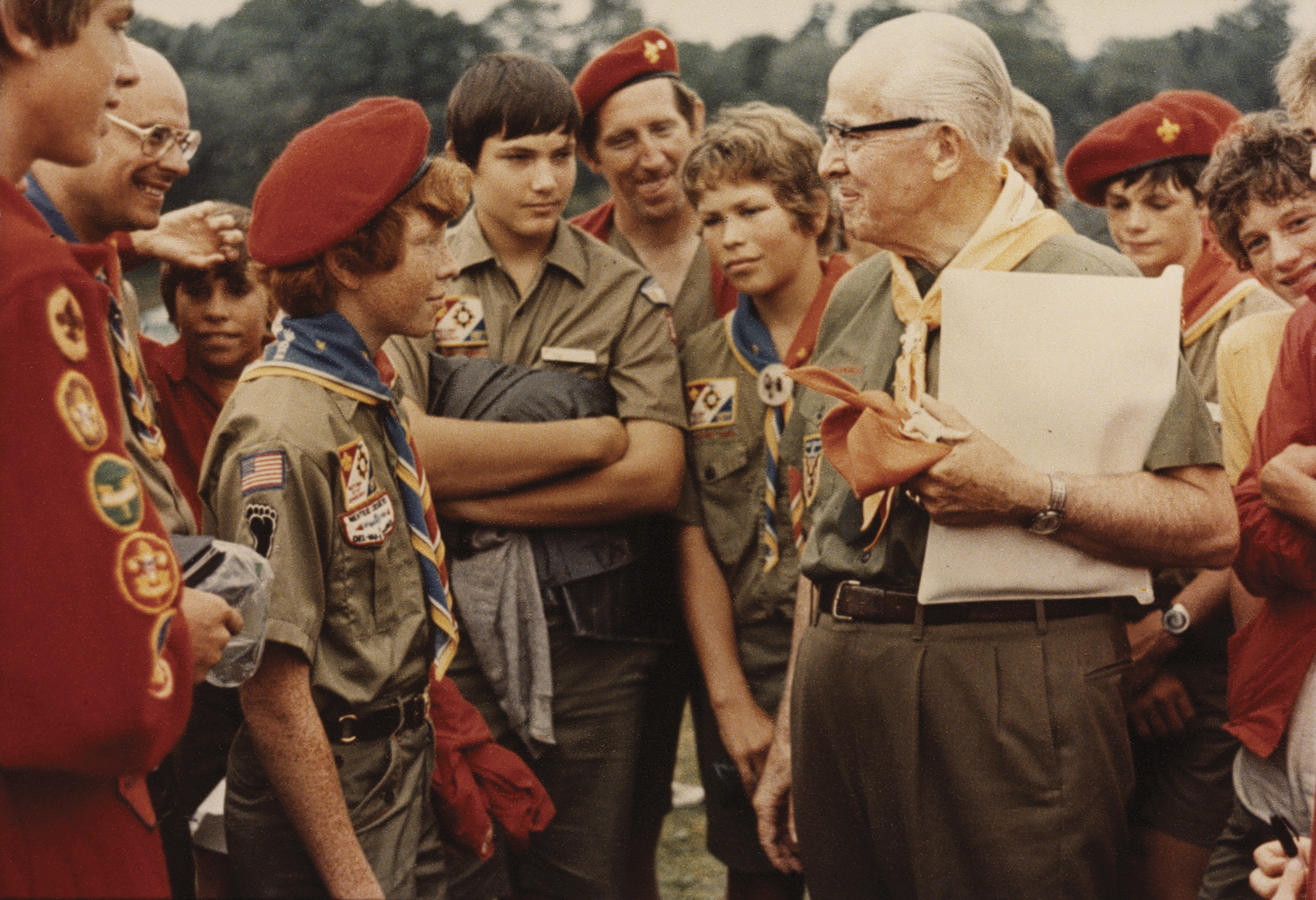 President Benson standing in Scout uniform with other Boy Scouts, around 1977.